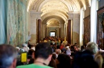 wall to wall people in a museum at the Vatican